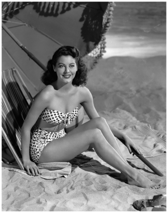 actress-ava-gardner-lounges-on-the-beach-in-a-spotted-bikini-1944