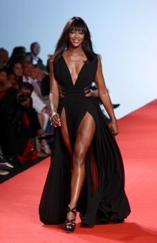 CANNES, FRANCE - MAY 16: Model Naomi Campbell walks the runway at Fashion For Relief at Forville market during the 64th Annual Cannes Film Festival on May 16, 2011 in Cannes, France. (Photo by Vittorio Zunino Celotto/Getty Images)